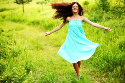 woman in blue dress enjoying grassy parthway