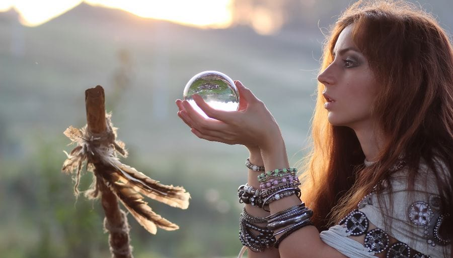 Woman Staring into Crystal Ball