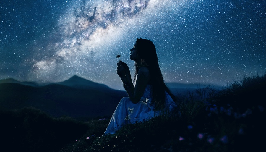 Girl Blowing Dandelion Under Milky Way Galaxy Sky