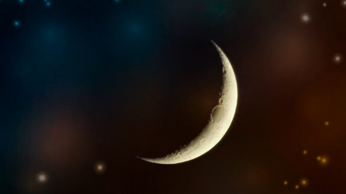 crescent moon on warm starry space - new moon abundance activation