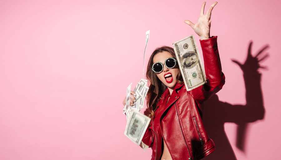 Girl throwing Money, pink background