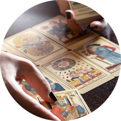 Tarot Card Reader Hands Performing Reading and Placing Cards in Spread