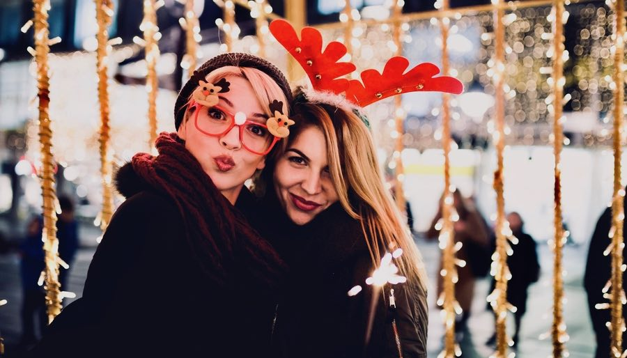 Two Female Friends Outside Celebrating Christmas