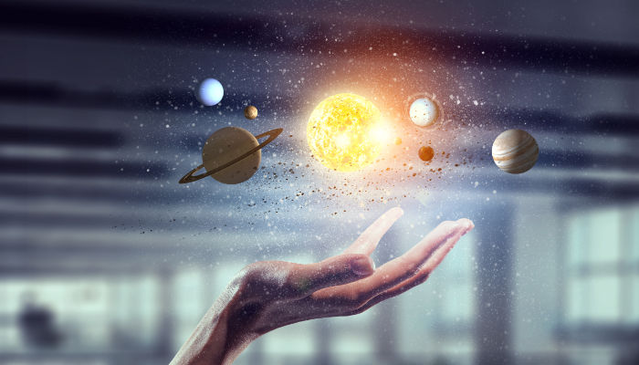 solar system at the palm of one's hand