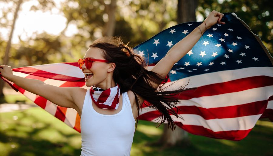 Woman Holding July 4th American Flag