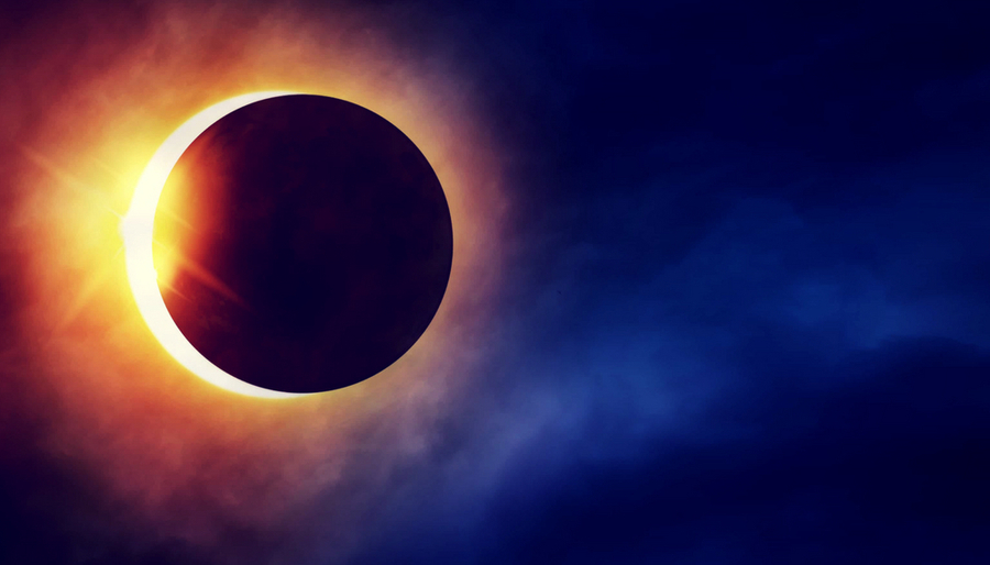 Partial Solar Eclipse on dramatic dark blue sky