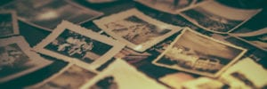 old family photographs scattered on the floor