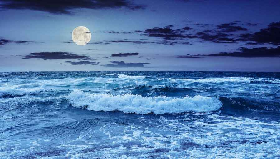 Pisces Full Moon rising over Dark Seascape