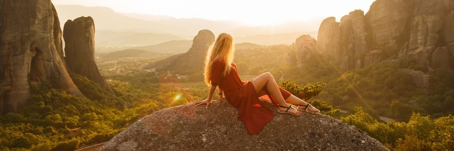 Woman in Red Dress Sitting Watching Sunrise