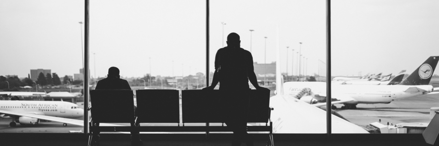 Silhouette of People Waiting in an Airport Lounge
