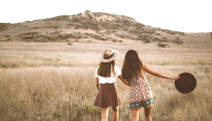 Sisters Waling through a Field at Dusk