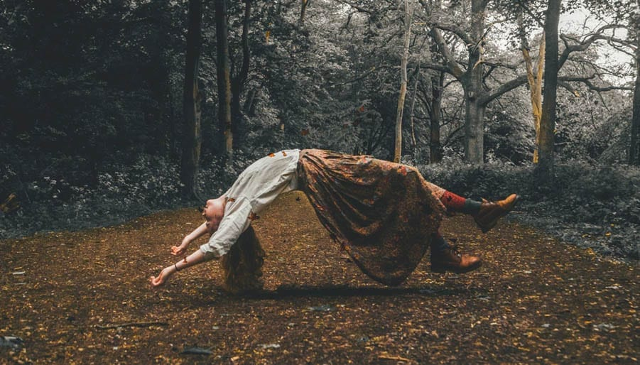 woman dreaming in the forest floating