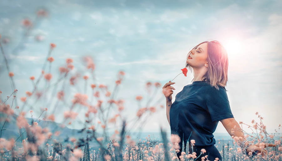woman embracing the colors of nature