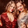 2 Young Female Friends in Sparkly Party Dresses