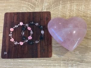 Rose Quartz Heart Crystal with Two Crystal Bracelets Overlapping Oracle Card