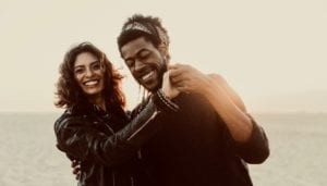 Happy, Laughing Couple wearing Leather Jackets