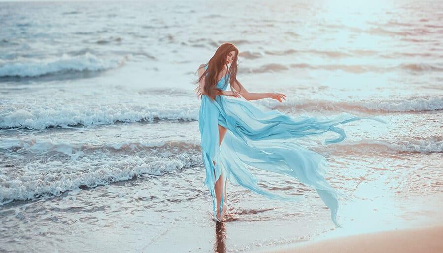 Mystic woman standing in the ocean